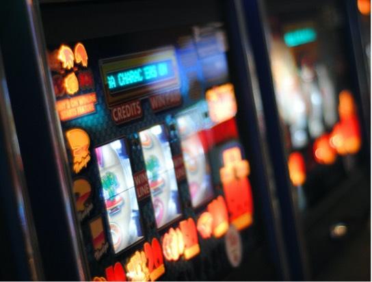 Close up image of a lit-up slot machine