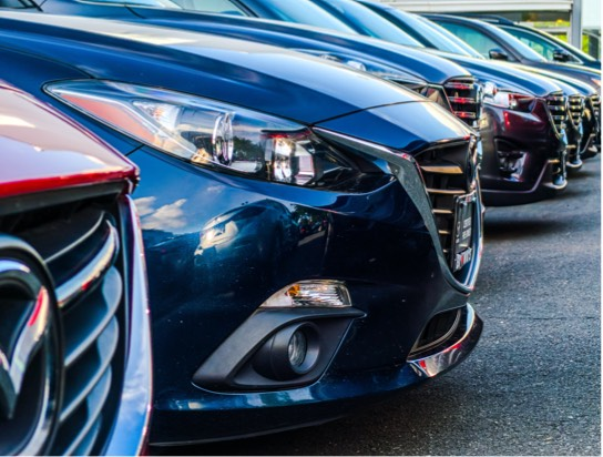 Close up image of cars parked in a parking lot