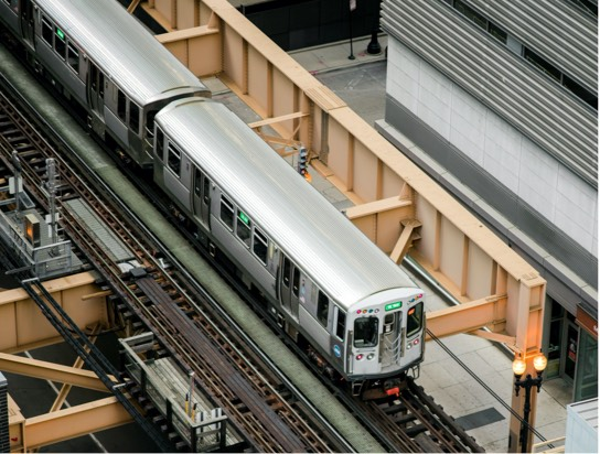 Overhead view of a train on elevated tracks