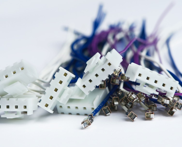 Close up photo of blue, white and purple VH Series Harness pieces