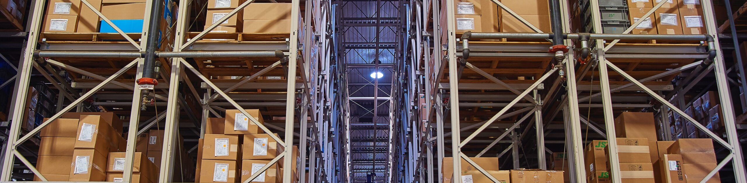 Boxes on large rows of shelving in the JST warehouse